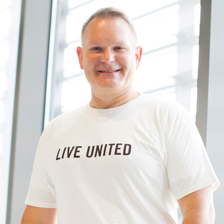 David Johnson wearing a T-shirt that says 'Live United'