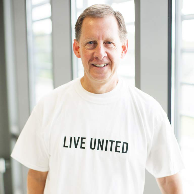 Kirk White wearing a T-shirt that says 'Live United'