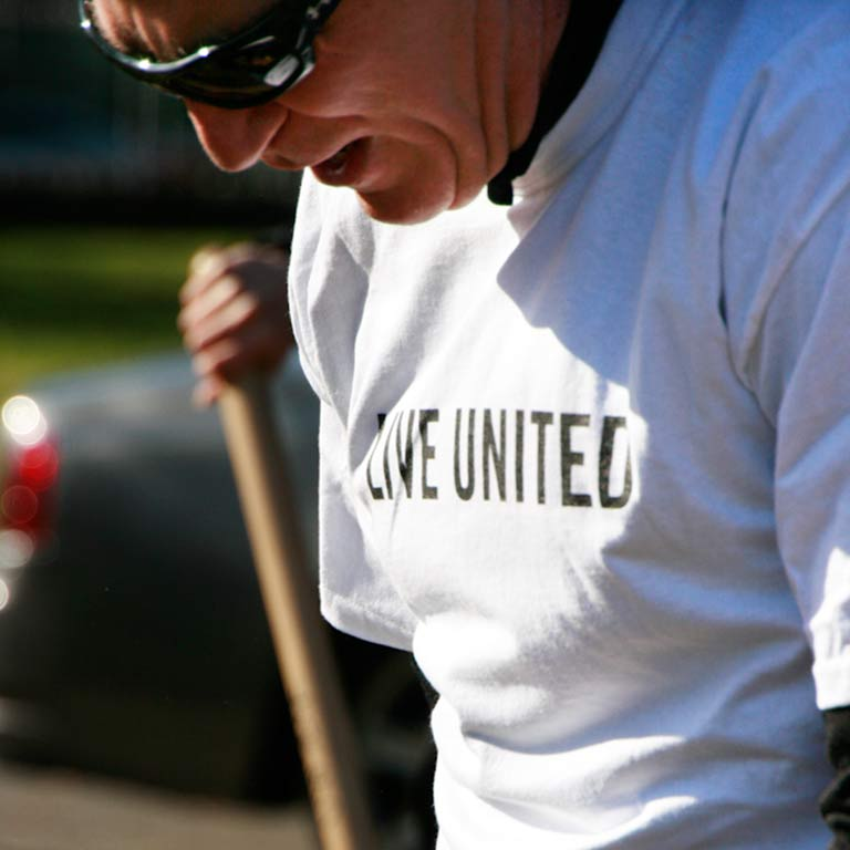 "Closeup of a volunteer wearing a ""Live United"" T-shirt"